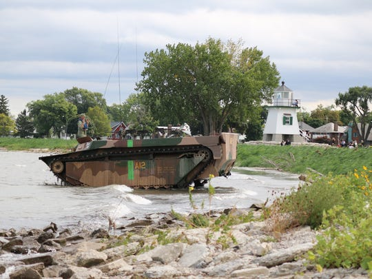 Tom Price, of the Ohio Motorpool, drives his 1945 LVT-4 Water Buffalo, a historic amphibious military vehicle, during the Port Clinton Homecoming Festival  at Waterworks Park on Saturday.