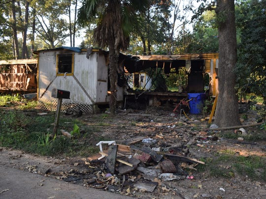 This burned-out mobile home on Bell Road in Pineville is across the street from the home of Terry Coleman's parents. Coleman is pushing for the burned-out structure and other uninhabitable residences on the road to be torn down to improve the quality of life on Bell Road.