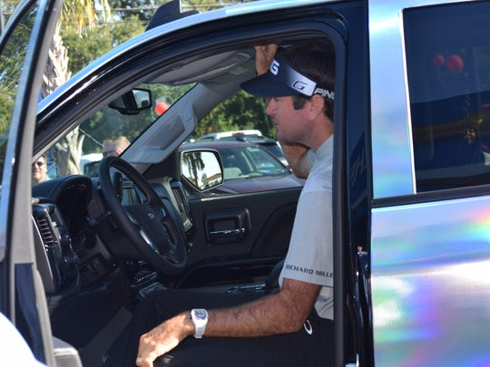 Bubba Watson checks out his new ride, a silver metallic