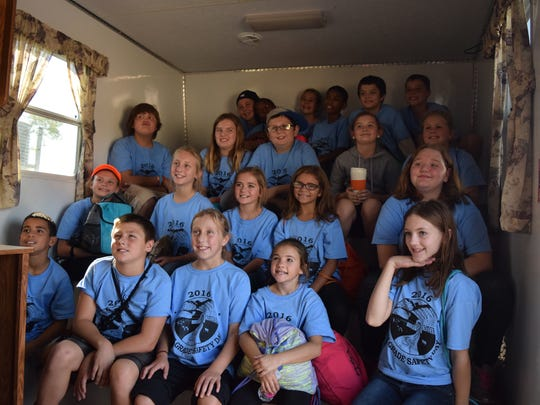 Mrs. Jennifer Crowley's fifth grade class from MES learn about fire safety in the Safety House at the event.