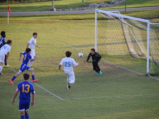 Josh Girten goes for the catch to prevent a Caldwell Co. goal.