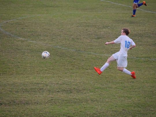 Daniel Steward sends the ball toward the goal.