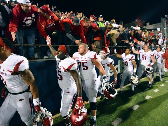 Arkansas Razorbacks players celebrate with fans after the game against Ole Miss in 2015 it won after a miracle 4th-and-25 conversion.