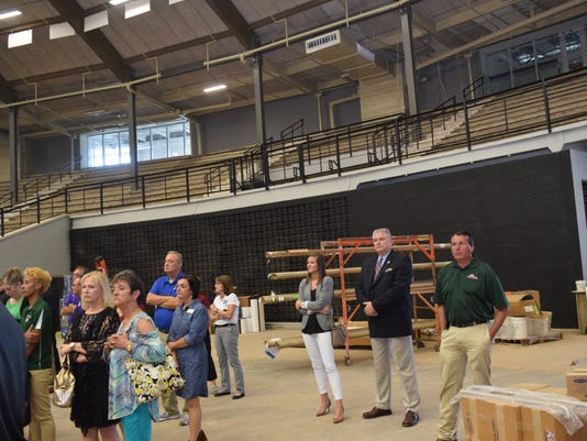 LHSAA exec. director Eddie Bonine (back, center right), along with LHSSA administrative assistant Hope Walley (back, left), visit the Rapides Parish Coliseum Wednesday along with other local dignitaries like David Gill (far right), chief of staff for the city of Alexandria mayor's office. The coliseum is under renovations. Bonine was visiting the site to see if it could host future LHSSA events.