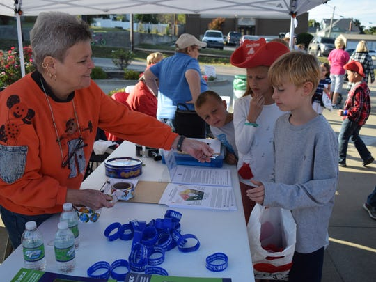 William Prendeville filling up his treat bag at the Fall Family Fun event.