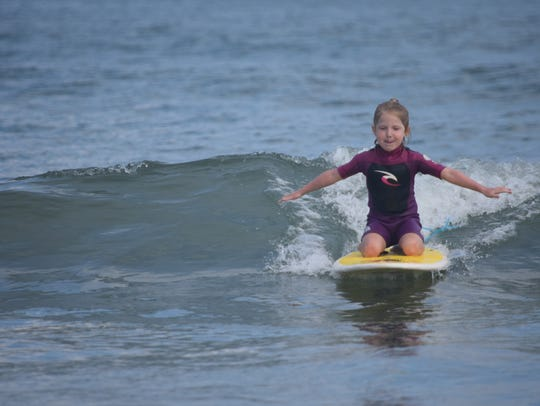 Six-year-old surfer Charlie Cox takes her time getting