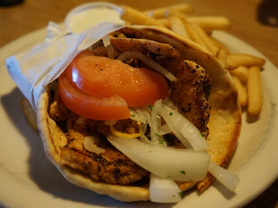 Grilled chicken, tomatoes and onion are wrapped in