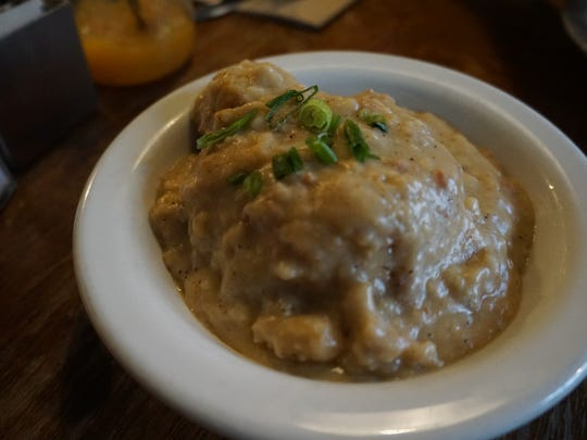 A spicy gravy completely engulfs a side of biscuits and gravy at The Universal.