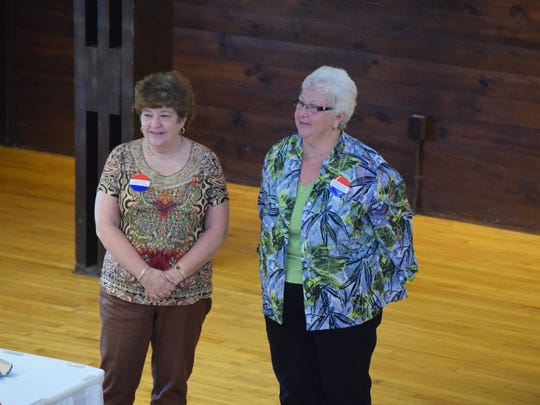 Secretary Karen Hill of Henderson County and President  Edna McCrady of Daviess County being installed into these new positions.