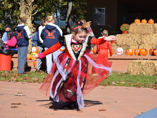 Addy Dutton, 5, of Millville dances in her costume