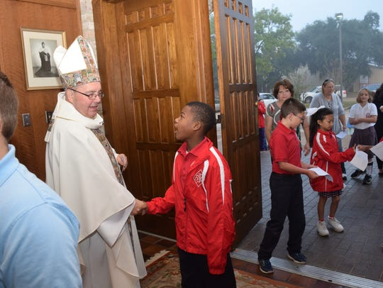 Newly named Memphis Catholic Diocese Bishop David Talley greets people at a mass in Alexandria, Louisiana.