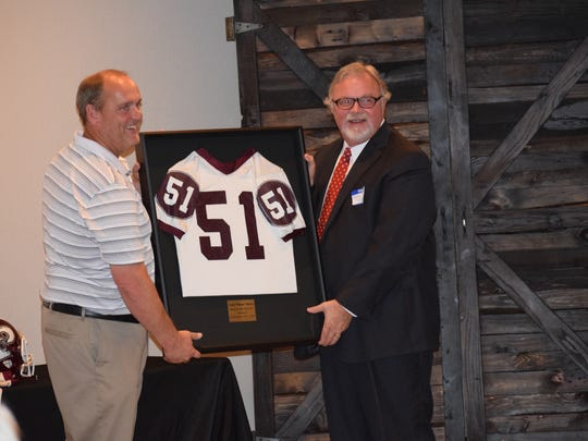"""Pensacola attorney Larry """"Moose"""" Morris, who played center and linebacker at Pensacola High was honored with his PHS jersey retirement Thursday night at V-Pauls Restaurant."""
