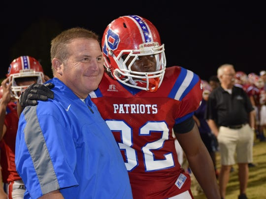 Pace senior running back Anthony Johnson enjoys a special moment with his position coach Bill Jernigan, after his final carry in high school went 78 yards for TD on night he became school's all-time record holder in rushing.