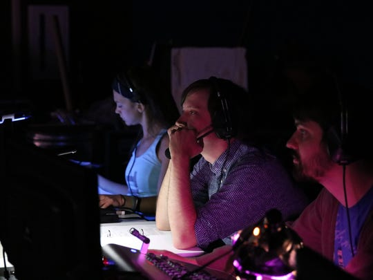 Mallory Hewell (stage manager), Jimmy Lawlor (lighting designer), and Graham Zellers (director of lighting) at Gulfshore Playhouse watch a musical number for fine-tuning.
