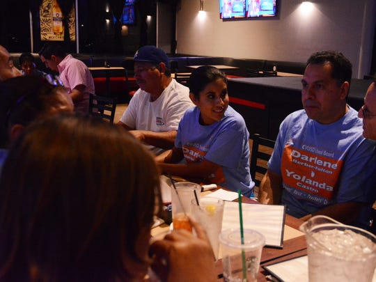 Yolanda Castro, center, celebrates with supporters after early election results show her with a strong lead. Castro is running for a seat on the Coachella Valley Unified School District Board.