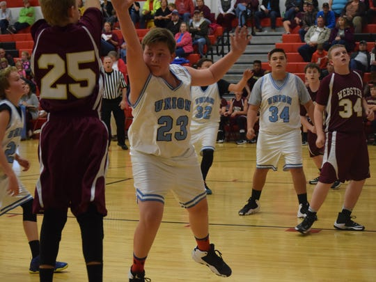 Seventh grader Gage Crowley blocks his opponent. The