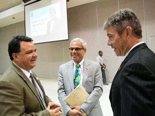 Jimmy Sawtelle (left), chancellor of Central Louisiana Technical Community College and Roy O. Martin III, (far right) a member of the Louisiana State Board of Regents, talk with Joseph Rallo, Louisiana's commissioner of higher education, at a public forum in Alexandria last year.