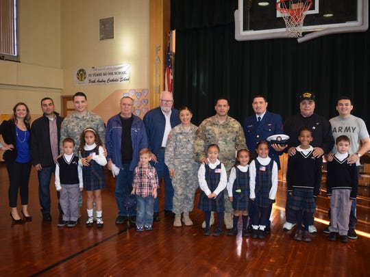 """Students and teachers at Perth Amboy Catholic Primary School hosted their annual """"Take A Veteran to School Day""""."""