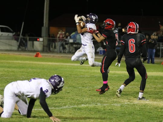 Yerington senior Anthony Madera makes a catch against Pershing County last month