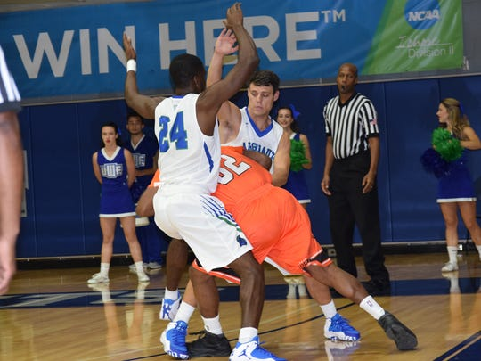 UWF's DJ Thorpe (24) and Jason Laatsch pressure Auburn-Montgmery;s Julius McCoy during the Argos 80-61 win Saturday night.