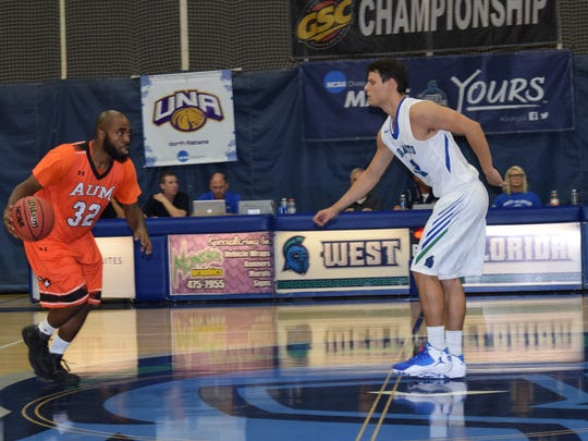 UWF's Jason Laatch, who led the team in scoring, guards Auburn-Montgomery's Julius McCoy in Saturday night's UWF win.