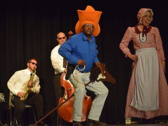 """Garrick Thompson and Mike Obert act as a house band for Bill Price and Carrie Divine in their performance of """"Along Came Jones."""""""