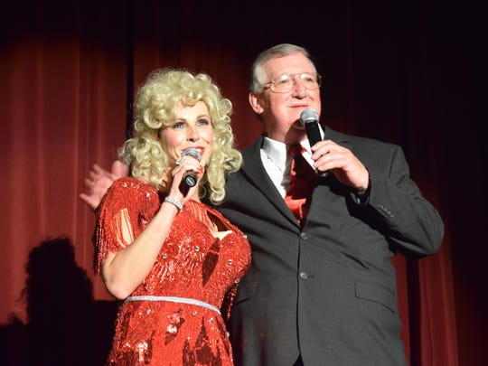 Malinda Beauchamp, dressed as Dolly Parton, and Johnny Robinson act as emcees for the night.