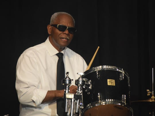James Watkins plays the drums throughout the show.