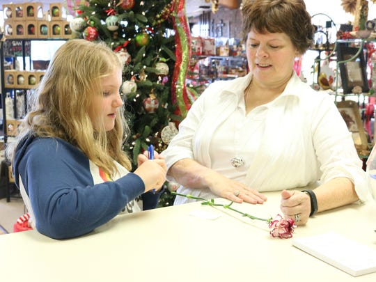 Gracie Arnett and Sonja Dalrymple enjoy conversation during the open house event at Danhauer's Florist & Gift Shop.