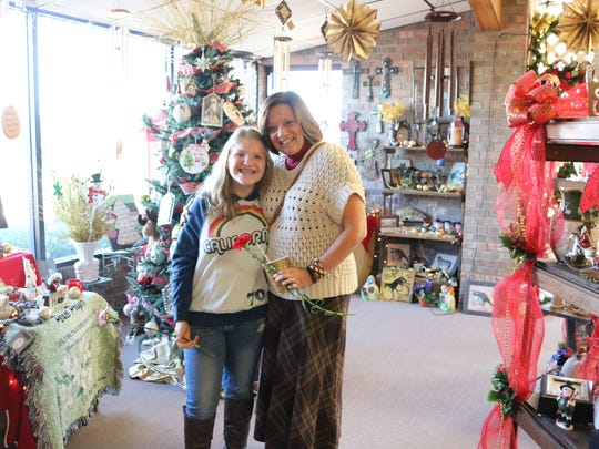 Gracie Arnett and Rhonda Burnette pose for a photo at Danhauer's during the open house.