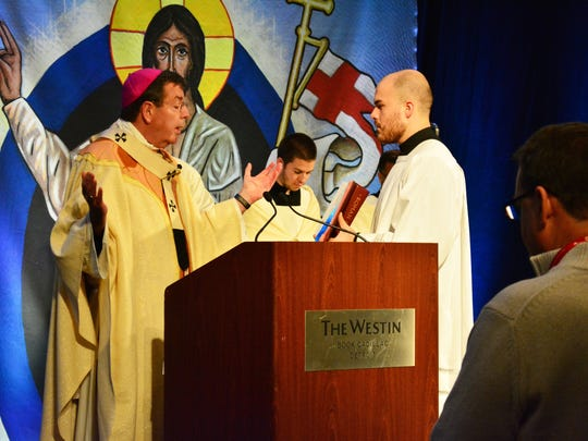 Archbishop Allen H. Vigneron officially opens the 11th general synod of the Archdiocese of Detroit as he prepares to lead a procession from the Westin Book Cadillac hotel to St. Aloysius Church in downtown Detroit.