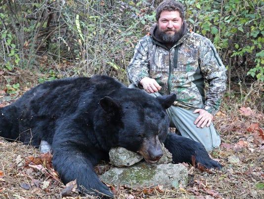 1 Grant Ruhl with bear