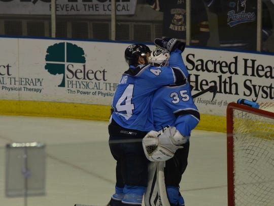 Ice Flyers defenseman Brandon Blair celebrates with goaltender Matt Zenzola following the Ice Flyers 2-1 win Wednesday  night against the Mississippi RiverKings at the Bay Center.