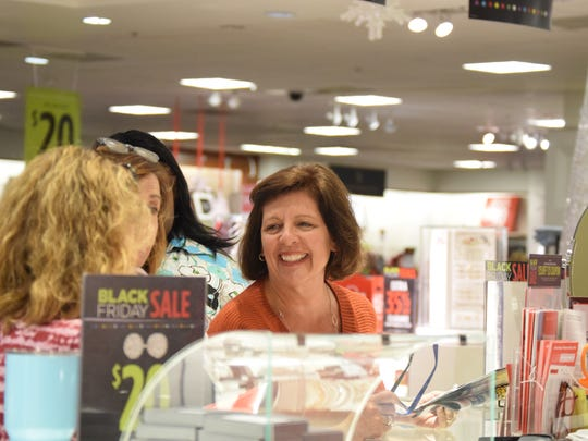 Nancy Leader smiles as she talks to a fellow customer
