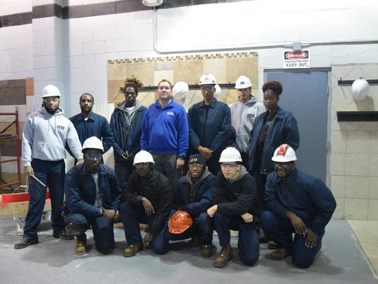 Students in the Job Corps Tile Program pose for a photo.
