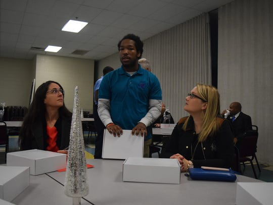 Job Corps student Christophre Deane speaks to council