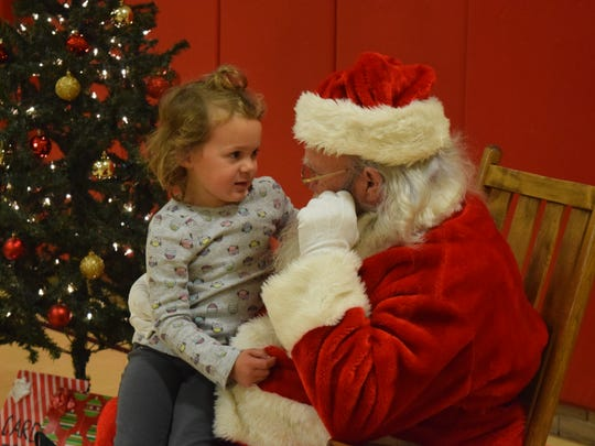 Jerra Johns tells Santa what she would like for Christmas.