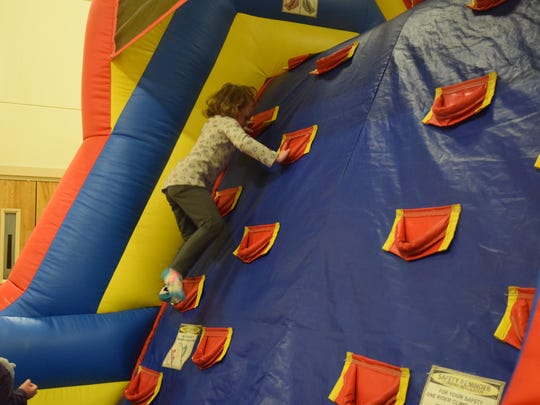 Jerra Johns makes her way up the bouncy house.