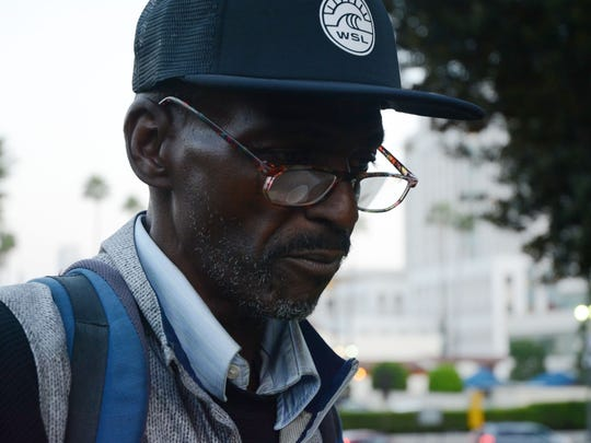 Wayne Woods, a homeless drug addict who was released by Prop 47, walks through a small park near Union Station in Los Angeles.