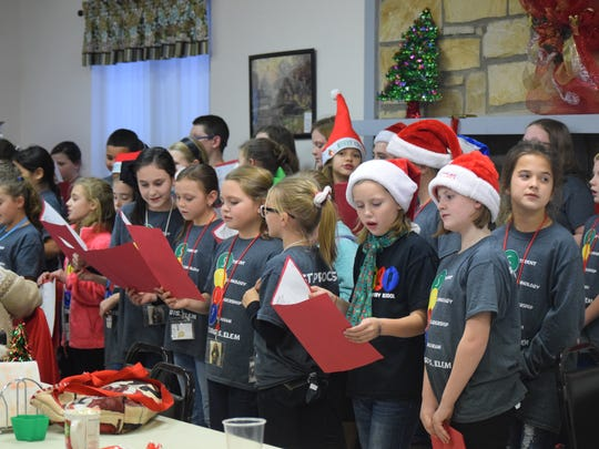 Students in STLP sing Christmas Carols to those in attendance.