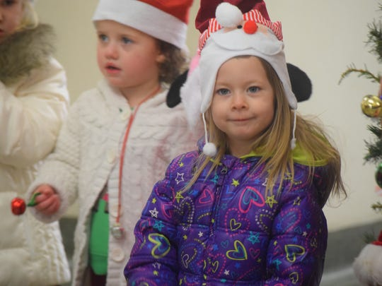 Shylee Holmes and Harper Mercer sing during the Time for Tots Christmas Caroling.