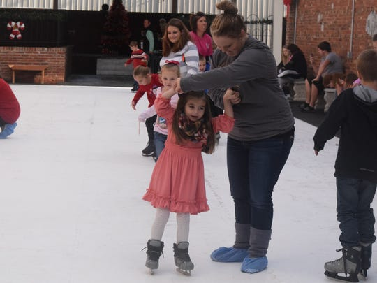 Abby Jo Rutter is spun around by her mother, Brittany Rutter at the Sturgis Snowflake Spectacular.