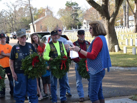 Kathy Scarborough helped organize the Wreaths Across America event at Alexandria National Cemetery Saturday. Scarborough became involved because she has sons in the military. She bought wreaths for the ceremony in October and has been trying to generate interest.