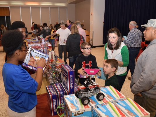 The Doll & Toy Fund Distribution was held Saturday, Dec. 17, 2016, at Alexandria Convention Hall. The Doll & Toy Fund is sponsored by the Alexandria Rotary Club and The Town Talk.