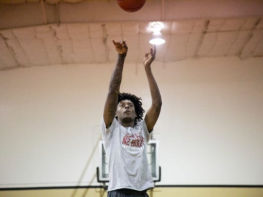 John Petty of Jemison High School shoots free throws at practice with his teammates on Friday at the Fort Myers YMCA.