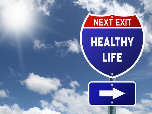An interstate road sign pointing to healthy life