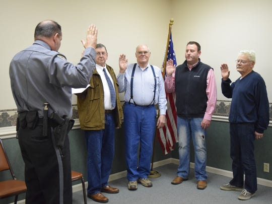 """Police Chief Dewayne Jackson administers the oath of office to the newly elected members of Sturgis City Council. Left to right, Mike Cowan, Pete Brown, Doug Rodgers, and Russell """"Nicky"""" Holeman."""