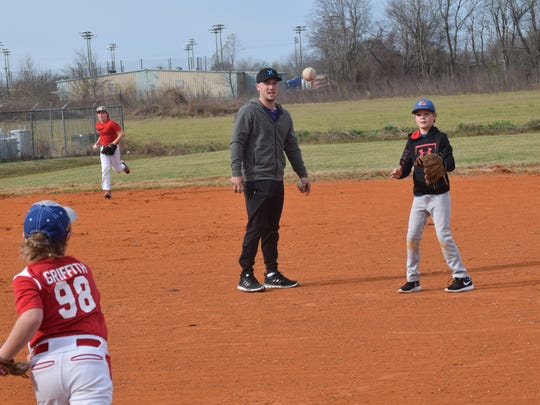 Alex Bregman (center), a former LSU player and an infielder for the Houston Astros, watches as Wyatt Griffith (bottom, left) and Cason Pool (far right) run through drills in a RakeCity baseball camp held at Next Level Academy Thursday.