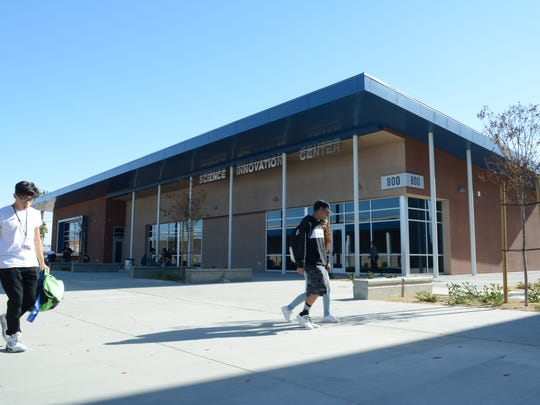 Students at Indio High School walk past the newly constructed science wing on campus, which opened the first week of January 2017.