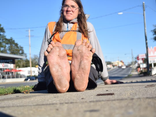 Matt Baumer's feet. He is walking barefoot cross-country to raise awareness for climate change.
